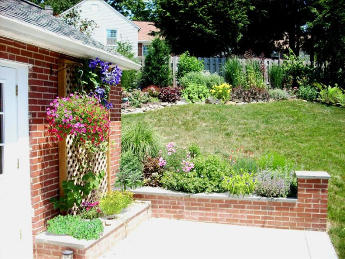 Backyard Designs - Garden With Wall and Perennials in Devon - After